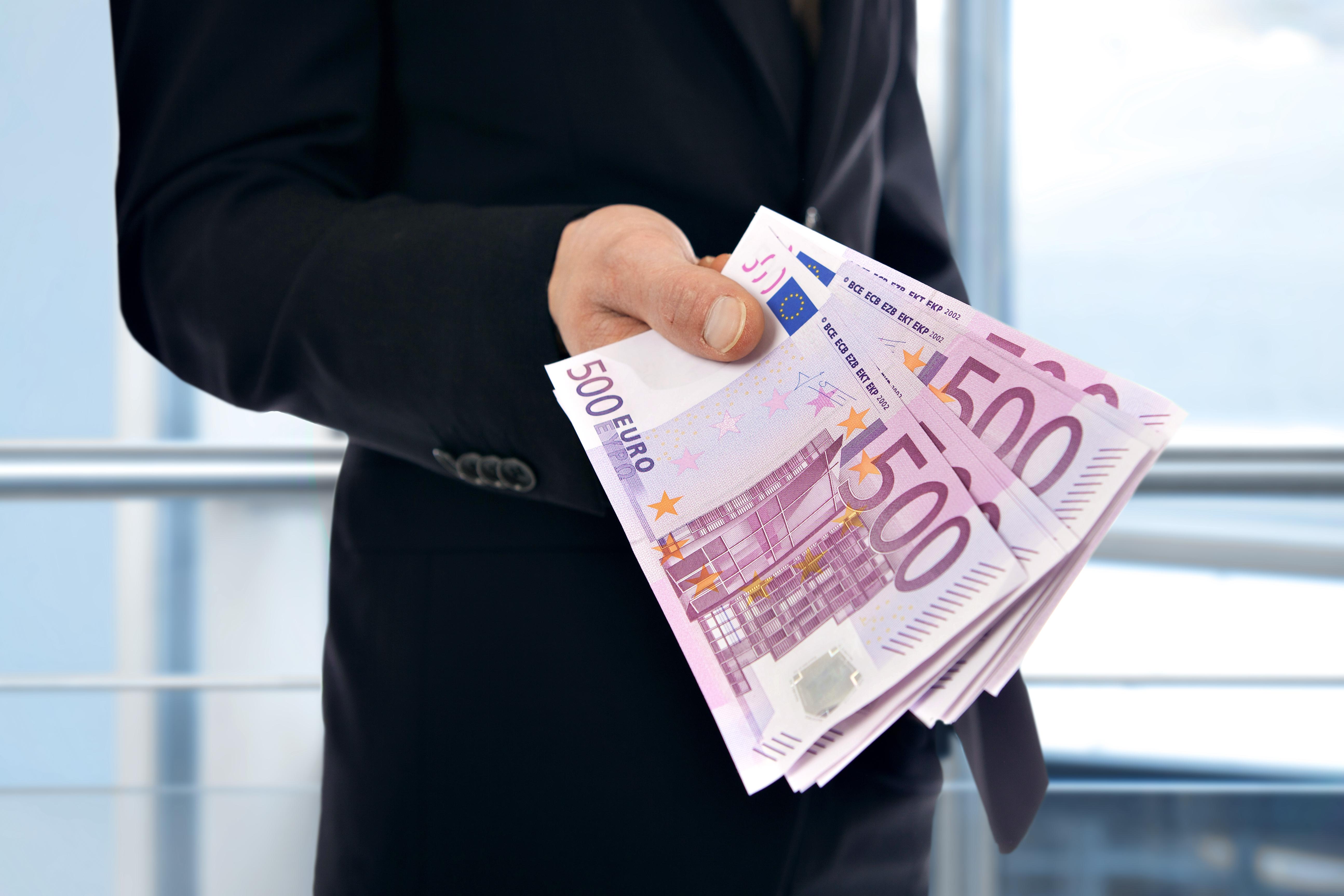 Businessman holding money - Euro (EUR)