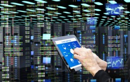 Woman's hand using digital tablet in data center